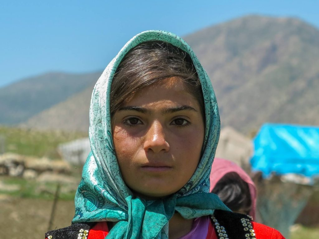 This is a photo of a young Kurdish girl living with her tribe.